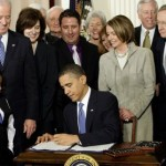 Obama signs the health care bill on March 23, 2010 (AP Photo/J. Scott Applewhite, File)