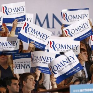(Republican presidential candidate Mitt Romney supporters cheer and wave signs after Romney was projected as the winner in the Illinois primary during his primary night rally in Schaumburg, Illinois, March 20, 2012. REUTERS/Jim Young)