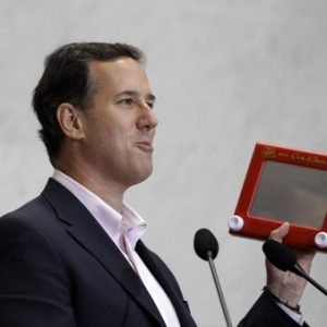 Republican presidential candidate, former Pennsylvania Sen. Rick Santorum holds an Etch A Sketch as he speaks to USAA employees during a campaign stop Thursday in San Antonio. (AP Photo/Eric Gay)