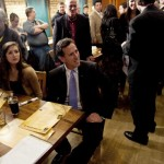 Rick Santorum watches election returns (REUTERS/Darren Hauck)