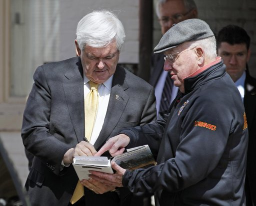 Gingrich autographis his book while campaigning in Annapolis, MD (AP Photo/Jose Luis Magana)