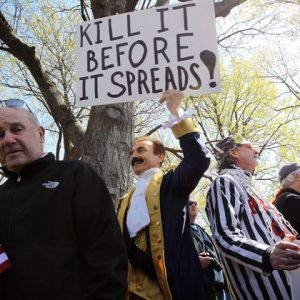 "Tea Party supporters participate in a ""Hands Off My Health Care"" rally at the Upper Senate Park March 27, on Capitol Hill in Washington, DC. A US Supreme Court justice seen as a key swing vote, challenged landmark health care reforms, as arguments focused on whether Americans can be forced to buy health insurance. (AFP Photo/Alex Wong)"