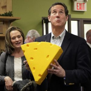 OK, WHO CUT THE CHEESE? Republican presidential candidate, former Pennsylvania Sen. Rick Santorum, accompanied by his wife Karen, holds a cheese head hat at Simon's Specialty Cheese in Appleton, Wis., Monday, April 2, 2012. (AP Photo/Jae C. Hong)