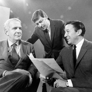 "This 1968 photo released by CBS shows ""60 Minutes"" correspondents Harry Reasoner, left, and Mike Wallace, right, with creator and producer Don Hewitt on the set in New York."