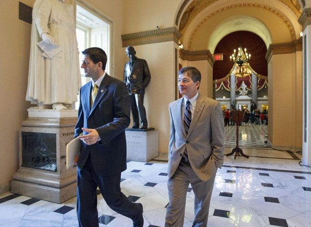 House Budget Committee Chairman Rep. Paul Ryan, R-Wis., left, and Rep. Jeb Hensarling, R-Texas, walk towards the House floor for the final vote on the payroll tax cut extension on Capitol Hill. (AP Photo/J. Scott Applewhite, File)