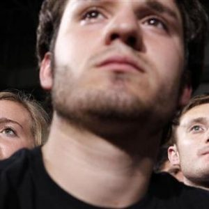 Students listen to U.S. President Barack Obama talk about the rising costs of student loans while at the University of Iowa in Iowa City. (REUTERS/Larry Downing)