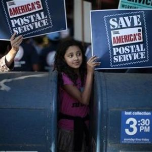Camila Rivera, 11, joins postal workers in a national day of protest last year against plans to close thousands of post offices, eliminate Saturday delivery, close mail processing facilities, cut service, and lay off 120,000 employees. (REUTERS/Lucy Nicholson)