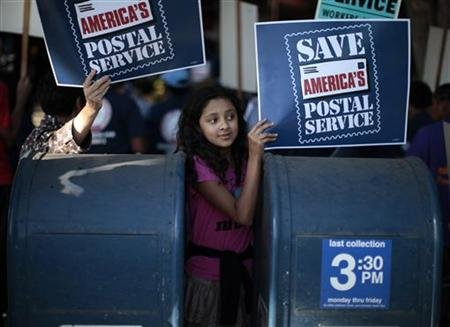 Camila Rivera, 11, joins postal workers in a national day of protest last year against plans to close thousands of post offices, eliminate Saturday delivery, close mail processing facilities, cut service, and lay off 120,000 employees.