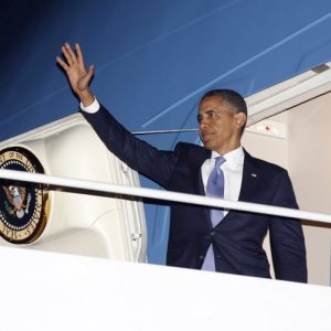 President Barack Obama waves as he boards Air Force One before his departure from JFK International airport in New York, Monday, July, 30, 2012. Obama traveled to New York for a private fundraiser.  (AP Photo/Pablo Martinez Monsivais)