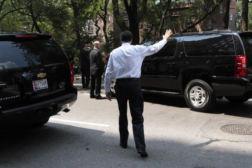 Republican presidential candidate, former Massachusetts Gov. Mitt Romney waves to onlookers as he leaves a finance event on 5th Ave in New York, Thursday, Aug. 9, 2012. 