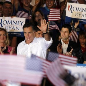 Republican presidential candidate, former Massachusetts Gov. Mitt Romney, center with his wife Ann, left, and his newly announced vice presidential running mate, Rep. Paul Ryan, R-Wis., right, during a campaign rally in Manassas, Va., Saturday, Aug. 11, 2012. 