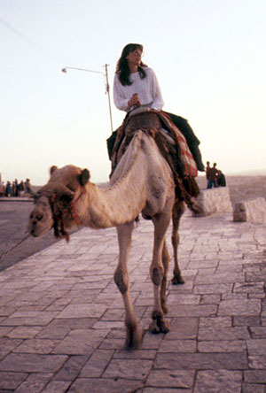 "Amy Thompson takes a ride on ""Kojack"" just outside of Bethlehem during a Congressional Delegation junket to Isreael in 1985.  She is the wife of Capitol Hill Blue publisher Doug Thompson, who was a staff member of the House Committee on Science & Technology at the time.