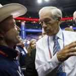 Rep. Ron Paul, R-Texas, talks with a Texas delegate on the floor at the Republican National Convention in Tampa. (AP Photo/Jae C. Hong)