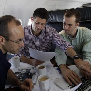 Republican vice presidential candidate, Rep. Paul Ryan, center, R-Wis., works on the speech he will deliver at the Republican National Convention, with senior adviser Dan Senor, left, and senior aid Conor Sweeney. during the campaign charter flight from Wisconsin to Tampa. (AP Photo/Mary Altaffer)