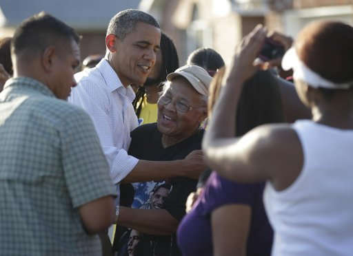 President Barack Obama greets local residents as he tours the Bridgewood neighborhood in LaPlace, La., in the Saint John the Baptist Parish for the ongoing response and recovery efforts to Hurricane Isaac, Monday, Sept. 3, 2012.  (AP Photo/Pablo Martinez Monsivais)