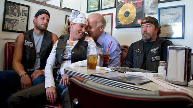 Vice President Joe Biden and his biker chick friend.  She's having fun but her companions don't appear amused. (AP Photo/Carolyn Kaster)