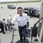 Republican presidential candidate and former Massachusetts Gov. Mitt Romney boards his campaign charter plane in Kansas City, Mo., after a refueling as he travels to Los Angeles, Sunday, Sept. 16, 2012.
