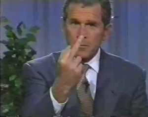George Bush giving the finger while running for office.  Probably one of the few times when he showed how he really felt.