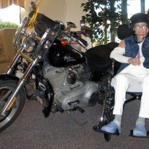 Ethel Bolt remembers her motorcycling days at her 86th birthday party in 1011. The Harley-Davidson belongs to her son.