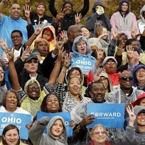 "Supporters cheer for ""four more years"" as U.S. President Barack Obama speaks during a campaign rally in Cleveland, Ohio October 5, 2012. 