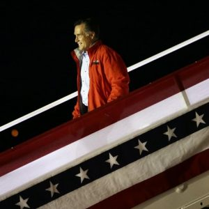 Republican presidential candidate and former Massachusetts Gov. Mitt Romney steps off his campaign plane in Weyers Cave, Va., Sunday, Oct. 7, 2012. 