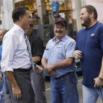 Republican presidential nominee Mitt Romney smiles while meeting members of the assembly line at Ariel Corporation before a town hall campaign stop in Mount Vernon, Ohio October 10, 2012. (REUTERS/Shannon Stapleton)