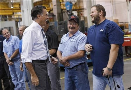Republican presidential nominee Mitt Romney smiles while meeting members of the assembly line at Ariel Corporation before a town hall campaign stop in Mount Vernon, Ohio October 10, 2012. 