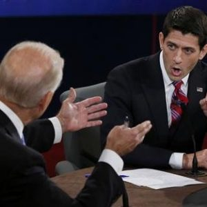 Vice President Joe Biden (L) and Republican vice presidential nominee Paul Ryan discuss a point during the vice presidential debate in Danville, Kentucky, October 11, 2012. 