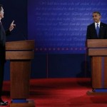 Republican presidential nominee Mitt Romney answers a question as U.S. President Barack Obama listens during the first presidential debate in Denver October 3, 2012.