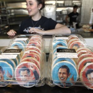 Amy Collella, a counter worker at the Oakmont Bakery, stands behind boxes of sugar cookies bearing the likenesses of President Barack Obama and Republican presidential candidate Mitt Romney, at the bakery on Wednesday, Oct. 17, 2012 in Oakmont, Pa. 