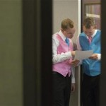 Dale Frost (L) and Mark Massey read their wedding certificate at the City Clerk's Office in New York October 11, 2012. 