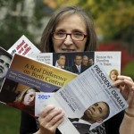 Jean Gianfagna displays some of the political mailers her family receives at her home in Westlake, Ohio. 