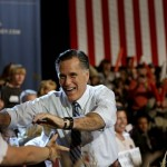 Republican presidential candidate, former Massachusetts Gov. Mitt Romney, greets supporters as he takes the stage for a campaign event at the Red Rocks Amphitheatre Tuesday, Oct. 23, 2012, in Golden, Colo. 