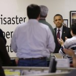 President Barack Obama visits the Red Cross National Relief Center (AP Photos by Pablo Martinez Monsivais)