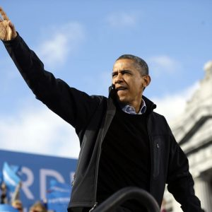 President Barack Obama waves to supporters during a campaign event at Capitol Square, Sunday, Nov. 4, 2012, in Concord, N.H. 