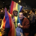 People celebrate early election returns favoring Washington state Referendum 74, which would legalize gay marriage, during a large impromptu street gathering in Seattle's Capitol Hill neighborhood, Tuesday, Nov. 6, 2012. The re-election of President Barack Obama and Referendum 74 drew the most supporters to the streets.