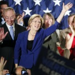 Democrat Elizabeth Warren, center, waves to the crowd with her husband Bruce Mann, left, during an election night rally at the Fairmont Copley Plaza hotel in Boston after Warren defeated incumbent GOP Sen. Scott Brown in the Massachusetts Senate race, Tuesday, Nov. 6, 2012. 