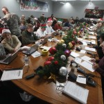 Volunteers take phone calls from children asking where Santa is and when he will deliver presents to their house, during the annual NORAD Tracks Santa Operation, at the North American Aerospace Defense Command, or NORAD, at Peterson Air Force Base, in Colorado Springs, Colo., Monday Dec. 24, 2012. Over a thousand volunteers at NORAD handle more than 100,000 thousand phone calls from children around the world every Christmas Eve, with NORAD continually projecting Santa&#039;s supposed progress delivering presents. (AP Photo/Brennan Linsley