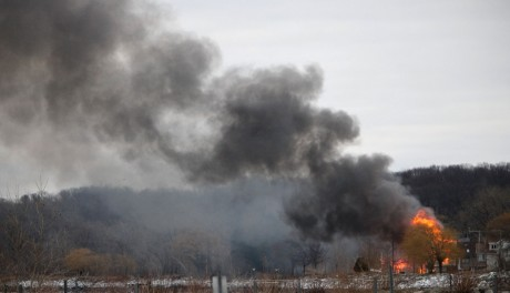 Homes burn on Lake Road, Monday, Dec. 24, 2012 in Webster, New York. A former convict set a house and car ablaze in his lakeside New York state neighborhood to lure firefighters then opened fire on them, killing two and engaging police in a shootout before killing himself while several homes burned. Authorities used an armored vehicle to evacuate the area. (AP Photo/Democrat &amp; Chronicle, Max Schulte)