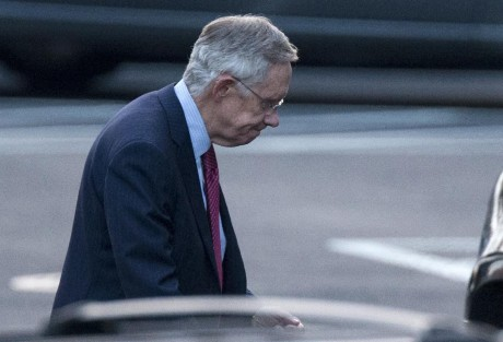 Senate Majority Leader Harry Reid of Nev. leaves the White House in Washington, Friday. (AP Photo/ Evan Vucci)