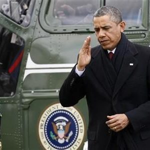 President Barack Obama (R) salutes as he returns via Marine One from a Christmas visit with his family in Hawaii, to the White House in Washington, December 27, 2012.  (REUTERS/Jonathan Ernst)