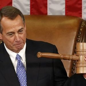 Speaker of the House John Boehner holds up the gavel after being re-elected on the first day of the 113th Congress at the Capitol in Washington.  REUTERS/Kevin Lamarque