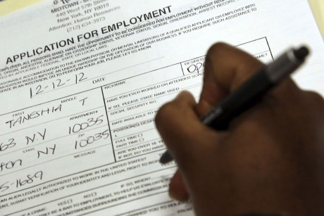 Taneshia Wright, of Manhattan, fills out a job application during a job fair in New York. Economists forecast that employers added 155,000 jobs in December, according to a survey by FactSet. That would be slightly higher than November's 148,000. The unemployment rate is projected to remain at 7.7 percent. (AP Photo/Mary Altaffer)