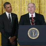 President Barack Obama (L) stands next to John Brennan, (R), during the announcement for his nominations for a new secretary of defense and new CIA director at the White House in Washington January 7, 2013.