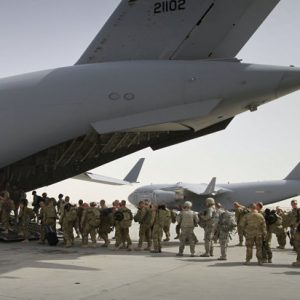 In this July 14, 2011, file photo, U.S. soldiers board a U.S. military plane, as they leave Afghanistan, at the U.S. base in Bagram north of Kabul, Afghanistan. The Obama administration gave the first explicit signal Tuesday, Jan. 8, 2013, that it might leave no troops in Afghanistan after December 2014, an option that defies the Pentagon's view that thousands of troops may be needed to keep a lid on al-Qaida and to strengthen Afghan forces. (AP Photo/Musadeq Sadeq, File)