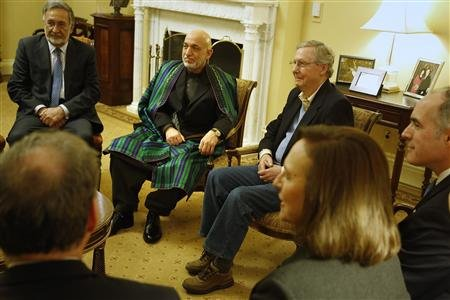 Afghan Foreign Minister Zalmay Rassoul, Afghan President Hamid Karzai and Senate Minority Leader Mitch McConnell (R-KY) prepare for a meeting with other senators including Sen. Deb Fischer (R-NE) (2nd R) and Sen. Bob Casey (D-PA) (R) at the U.S. Capitol in Washington January 9, 2013. (REUTERS/Jonathan Ernst)