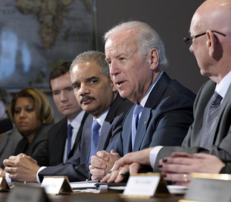  Vice President Joe Biden, with Attorney General Eric Holder at left, speaks during a meeting with victims' groups and gun safety organizations in the Eisenhower Executive Office Building on the White House complex in Washington, Wednesday, Jan. 9, 2013. Biden is holding a series of meetings this week as part of the effort he is leading to develop policy proposals in response to the Newtown, Conn., school shooting (AP Photo/Susan Walsh)