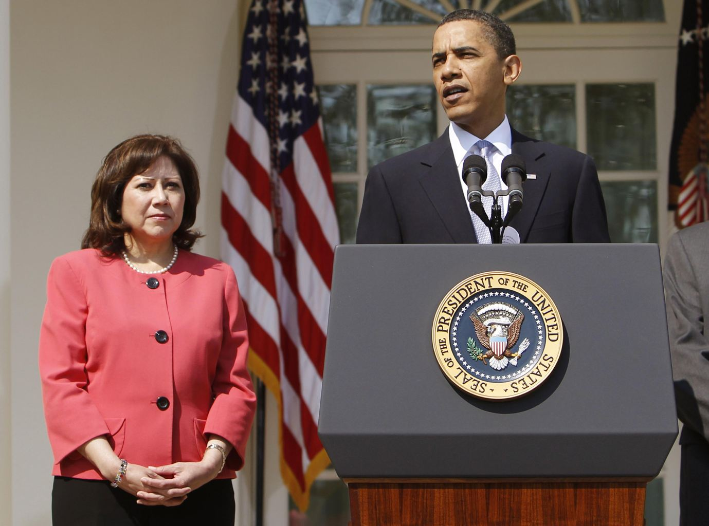 This April 15, 2010 file photo shows Labor Secretary Hilda Solis standing with President Barack Obama in the Rose Garden of the White House in Washington. Solis is telling colleagues she is leaving the Obama administration.  (AP Photo/Charles Dharapak, File)