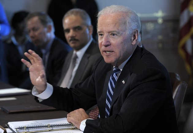 Vice President Joe Biden, accompanied by Attorney General Eric Holder, gestures as he speaks during a meeting with Sportsmen and Women and Wildlife Interest Groups and member of his cabinet, Thursday, Jan. 10, 2013, in the Eisenhower Executive Office Building on the White House complex in Washington. Biden is holding a series of meetings this week as part of the effort he is leading to develop policy proposals in response to the Newtown, Conn., school shooting  (AP Photo/Susan Walsh)