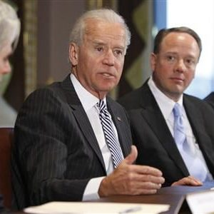 Vice President Joe Biden flanked by video game execs and others at meeting. (Reuters)